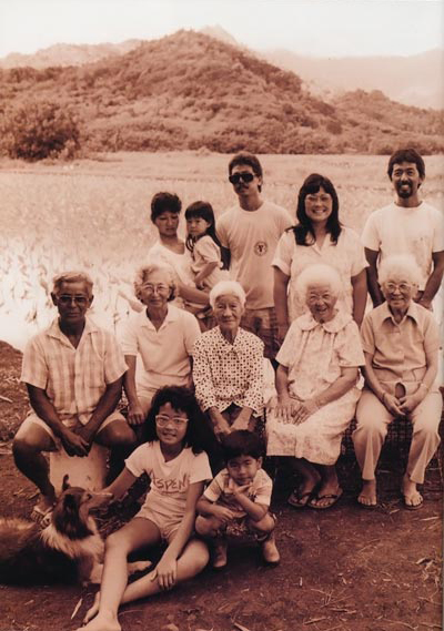 The Haraguchi family in the taro fields of Hanalei