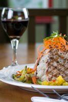 A glass of wine and some grilled fish at the Lighthouse Bistro