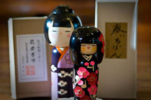 Two very cute Kokeshi Dolls with floral patterns at kong Lung