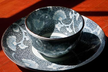 Imported Japanese suacer and bowl by Miya. Pattern shown in Ginkgo.