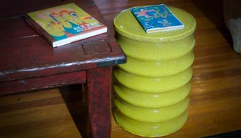 The Yellow Green bamboo Garden Stool as an end table
