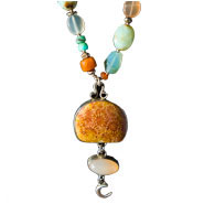 Fossilized Coral pendant on a necklace from Moonbox Studio