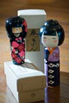 Two super cute wooden kokeshi dolls with flowers